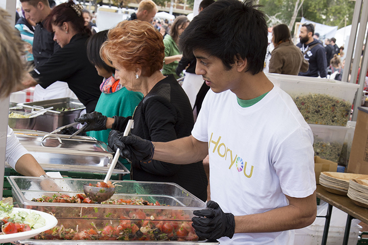 "Horyou volunteer serving food at ""The Meal"""