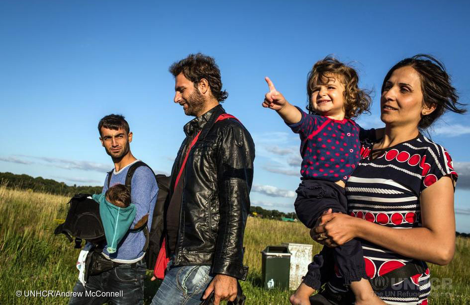 Dara and Naleen are reunited with Merkhaz who arrived the previous day, and the group walk towards the reception centre for asylum seekers, in Ter Apel, Holland. Ter Apel is the location of the only reception centre in Holland for asylum seekers. Dara decided to take his family here after speaking to other members of the Kobane group who had arrived in Germany. They told him that conditions in Germany were crowded, with new arrivals being put in tents. ; The group is made up of over 20 Kurdish refugees who left Kobane at various times since September 2014 and came together in Turkey in order to travel together to Europe. Almost all have had their homes destroyed in Kobane and many have lost relatives and friends in the violence that began when ISIS first besieged the town in September 2014. The group consists of 4 families and a few single men and teenagers, many of them are relatives.