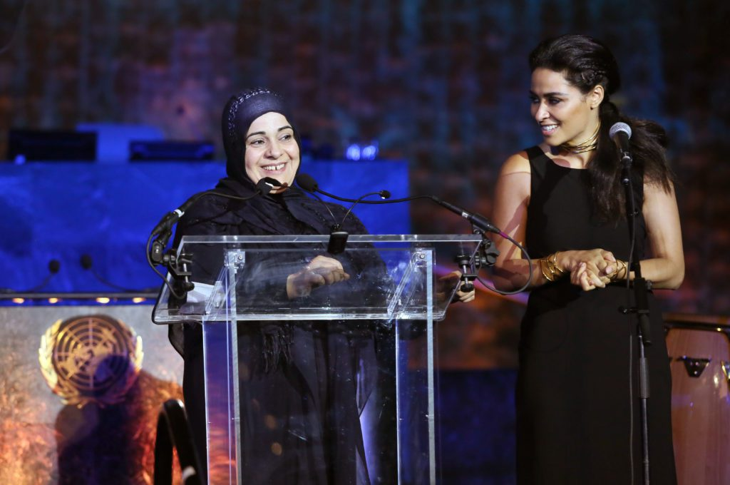 Lebanese actress Yasmine Al Massri introduces Hala Kamil, subject of the the documentary 'Children of Syria,' at the One Humanity event