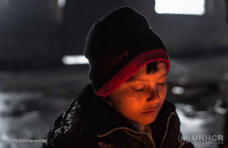 Aziz Jabarkheil, 8, is Afghan and waits for the return of his uncle in an abandoned warehouse in Belgrade.